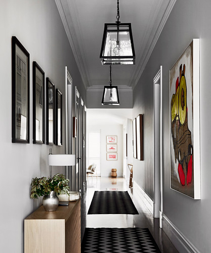 Image gallery in the hallway with light gray walls