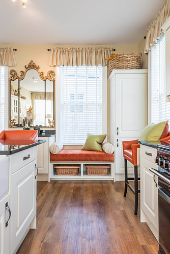 Window seat in country-house-style kitchen-dining room