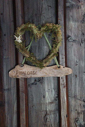 Heart made from moss and lichen with edelweiss flower and wooden pendant