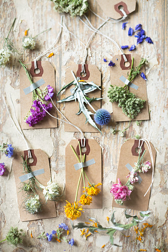 Dried flowers stuck on labels