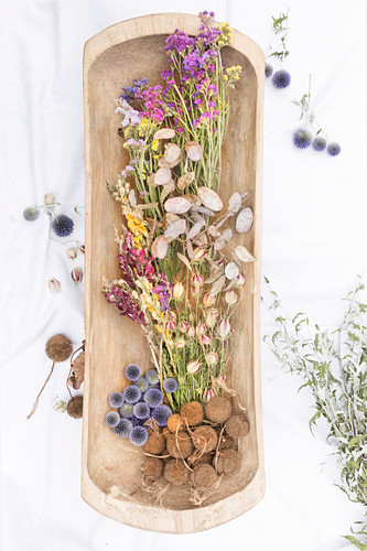 Dried flowers in wooden dish