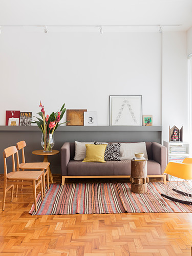 Scatter cushions on sofa, side table and chairs in living room