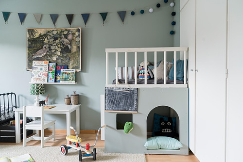 Play house with platform on top, table and chair in child's bedroom