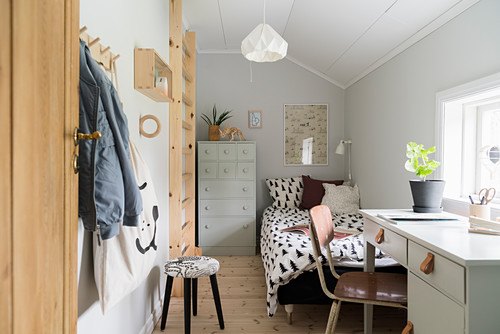 Small child's room in vintage style with sloping ceiling