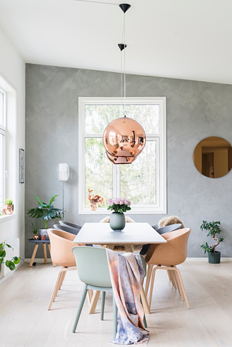 Table and shell chairs in bright dining room