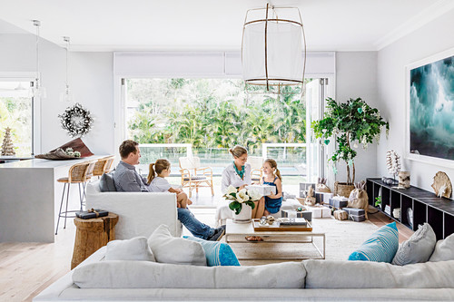 Family celebrates Christmas in the exotic living room