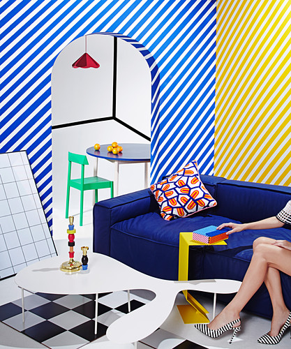 Diagonally striped walls in the brightly colored living room