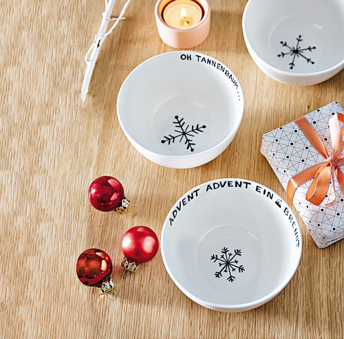 Bowls painted with Christmas words and snowflakes