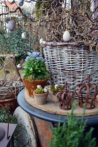 Basket With Branches Of Corkscrew Easter Eggs Decorated With Eggs