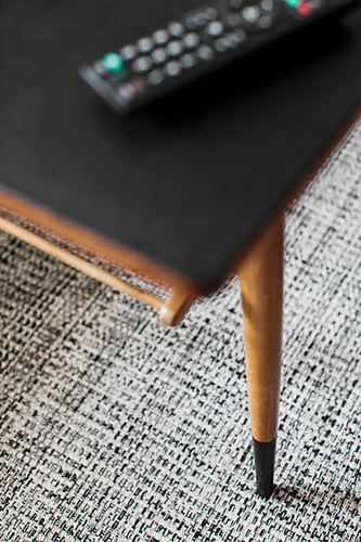 Table with top covered in black adhesive film