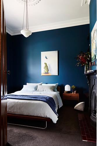 Classic bedroom with dark blue walls