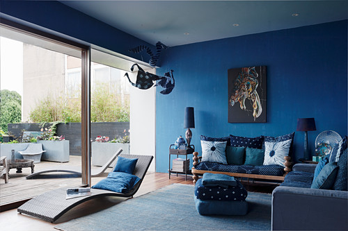 Blue living room with glass sliding wall
