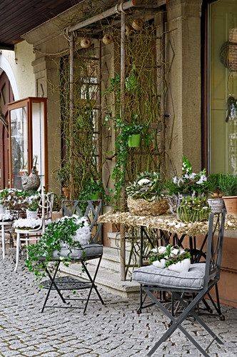 Tables and chairs decorated for Easter outside house