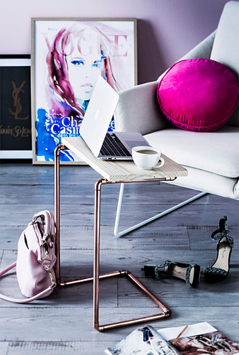 DIY side table made of copper tubing and plywood