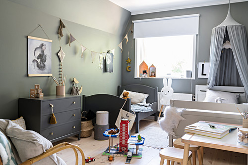 Twin beds in children's bedroom in shades of grey