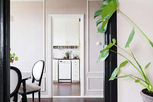 View through several doorways into kitchen