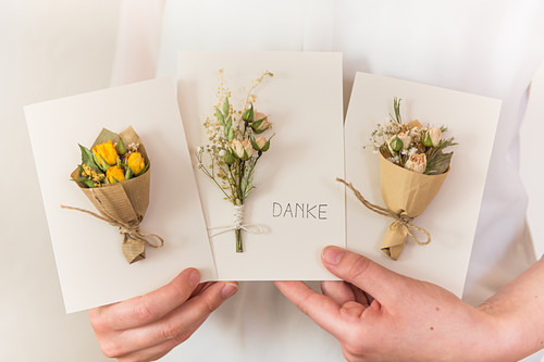 Handmade cards decorated with dried flowers
