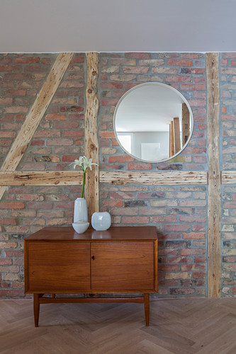 Sideboard against brick wall in period apartment