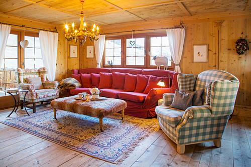 Sofa and armchairs in interior of traditional Swiss farmhouse