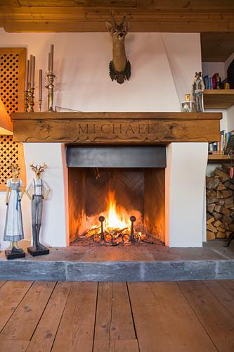 Lit open fire in traditional Swiss farmhouse