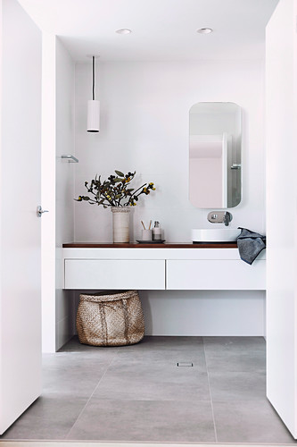 Simple modern bathroom in white with gray tiled floor