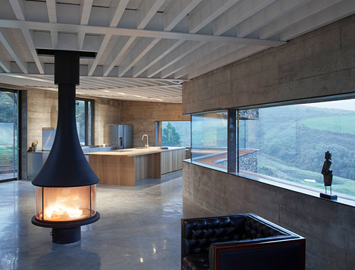 Free-standing fireplace in minimalist, architect-designed house