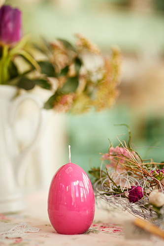 Pink Easter-egg candle decorating table