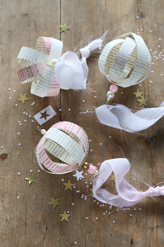 Christmas baubles handcrafted from coloured book pages