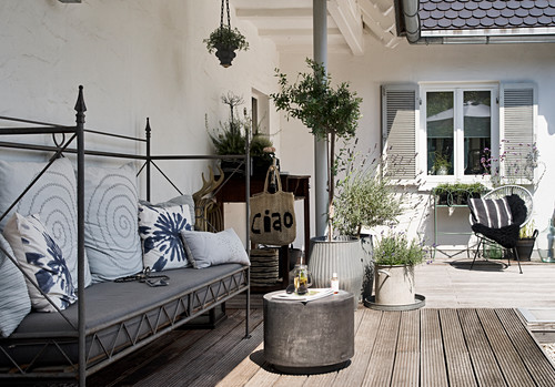 Sofa with country-house metal frame on wooden deck