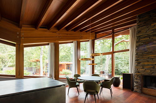 Dining room with glass wall in sustainable, architect-designed house