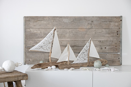 Sailing boat ornaments made from driftwood and fabric remnants