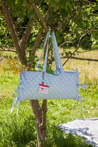 Hand-sewn combination picnic bag and cushion