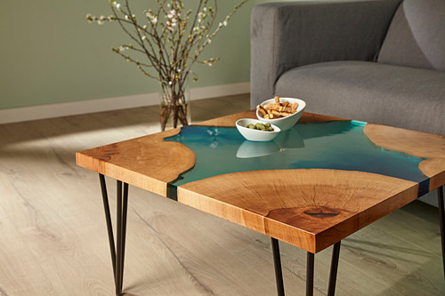 Handcrafted coffee table made from wood and epoxy resin with hairpin legs