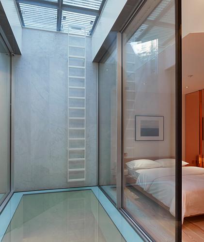 Minimalist bedroom with glass wall