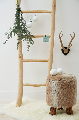 Christmas decorations on ladder