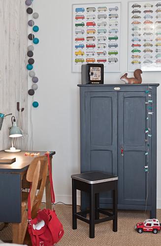 Old furniture in vintage-style child's bedroom