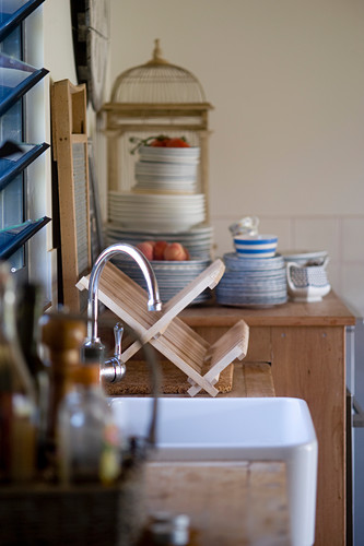 Sink, draining rack and stacked plates
