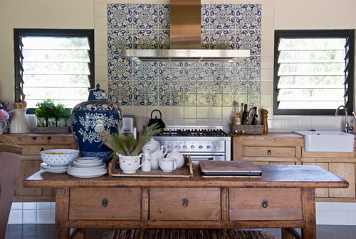 Crockery on wooden kitchen table with drawers