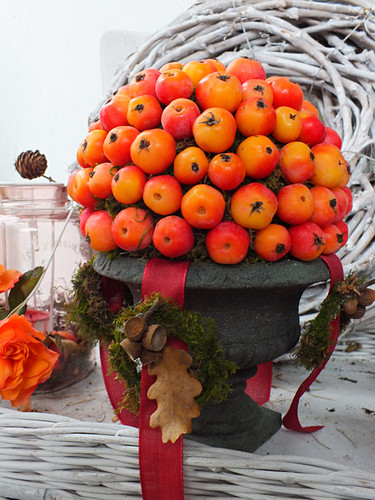Arrangement of crab apples in urn