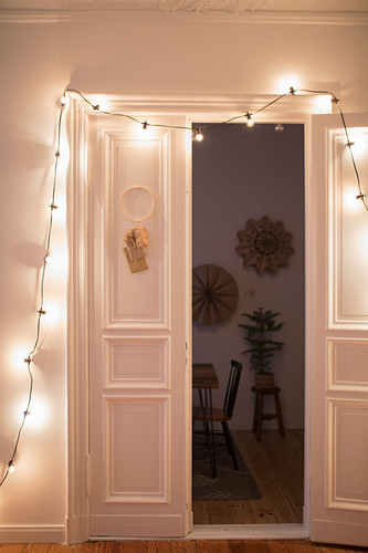 DIY Advent calendar and fairy lights hung on white door