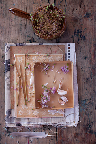 Vintage-style arrangement with garlic cloves and flowers