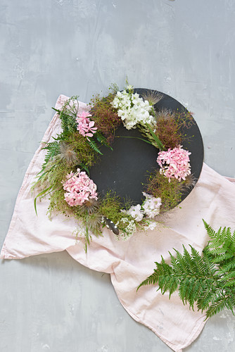 Wreath of flowers and seed heads decorating table