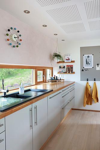 Pale kitchen counter below ribbon window