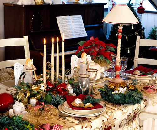 Christmas table decoration with angels and candles