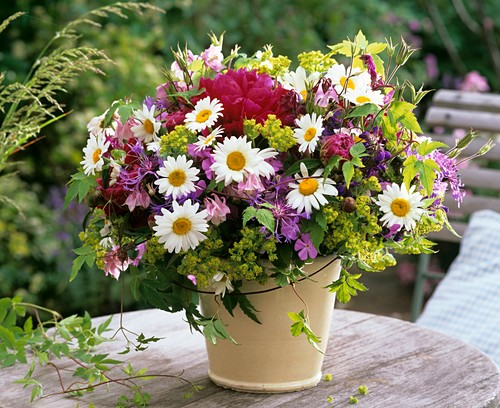 Arrangement of spring flower on a wooden table out of doors