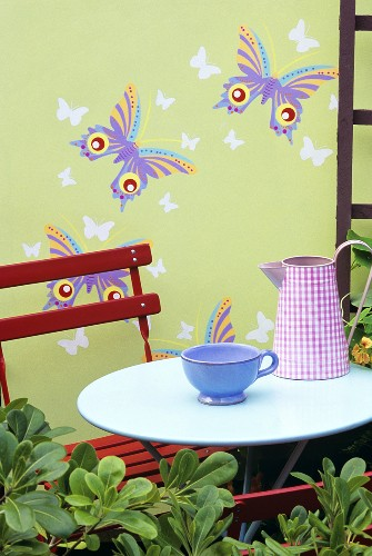 Jug and cup on garden table out of doors