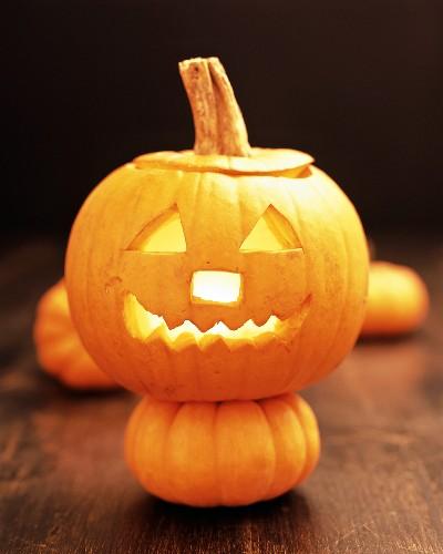 Pumpkin lantern on small pumpkin for Halloween