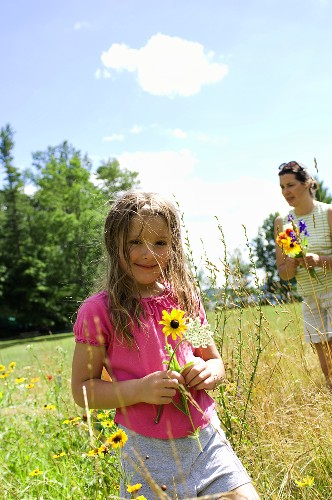 Mother and Daughter Picking Wildflowers