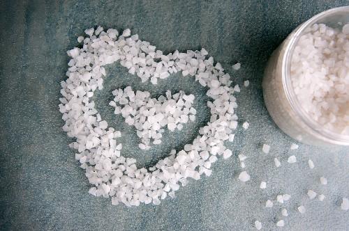Bath salts in a heart shape and a tin of bath salts (close-up)