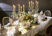 Festively Set Table with Candleabras and Violets